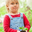 Child with sprout — Stock Photo