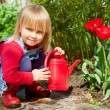 Child with watering can — Stock Photo