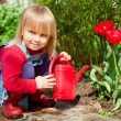 Child with watering can - Photo