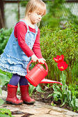 GIrl with watering can — Stock Photo