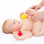 Baby massage — Stock Photo