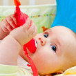 Infant with teething toy — Stock Photo