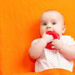 Infant with teething toy - Stock Photo