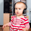 Toddler with headphones - Stock Photo