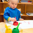 Child at painting lesson — Stock Photo #13671448