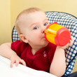 Baby with cup — Stock Photo