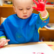Child painting with hand — Stock Photo