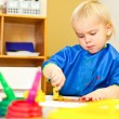 Child at painting lesson — Stock Photo #13671492