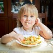 Child with pasta — Stock Photo #13671525