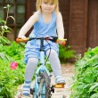Girl on a bicycle — Stock Photo #13671530