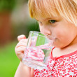 Child with cup of water — Stock Photo