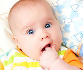 Infant with hand in mouth — Stock Photo