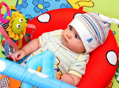 Infant in baby gym — Stock Photo