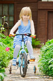 Girl on a bicycle — Stock Photo