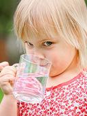 Child drinking water — Stock Photo