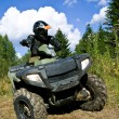 Sportsman riding quad bike — Stock Photo