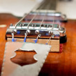 Old bass guitar detail — Stock Photo #13739954