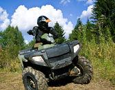 Sportsman riding quad bike — Stock Photo