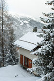 House in a winter mountain — Stock Photo