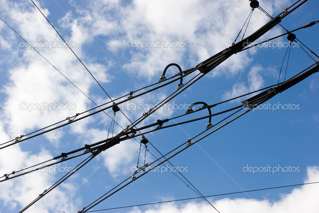 Suspended tramway power cables against  blue sky with clouds — Stock Photo #13739346