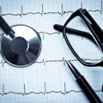Stethoscope on EKG — Stock Photo #13740606