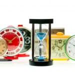 Hourglass and alarm clocks — Stock Photo #13741350