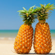 Pineapples on beach — Stock Photo #13741657