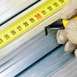 Steel stud measuring — Stock Photo