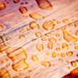 Rain drops on a sealed wood - Stock Photo
