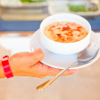 Hand holding soup — Stock Photo