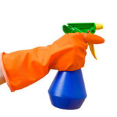 Hand holding spray bottle — Stock Photo