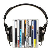 Headphones on stack of CDs — Stok fotoğraf
