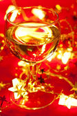 Wineglass with Christmas decoration — Stock Photo