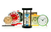 Hourglass and alarm clocks — Stock Photo