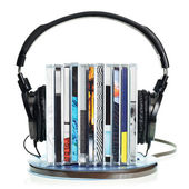 Headphones on stack of CDs and a reel tape — Stok fotoğraf