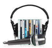 Headphones on stack of CDs with microphone — Stok fotoğraf