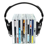 Headphones on stack of CDs — Stockfoto