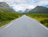 Straight and empty mountain road — Stock Photo