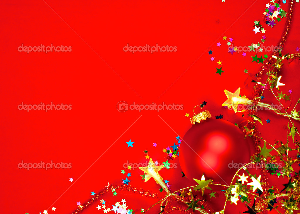 Christmas bauble with star-shaped lights and tinsel on red background — Stock Photo #13740635