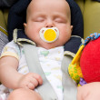 Baby sleeping in a car seat — Stock Photo