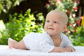 Baby in a summer garden — Stock Photo