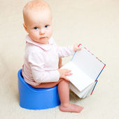 Infant on potty — Stock Photo