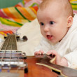 Infant and the bass guitar — Stock Photo #14760793