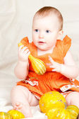 Infant with pumpkin — Stock Photo