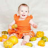 Infant with pumpkins — Stock Photo