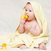Infant in towel — Stock Photo