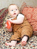 Infant with red torus — Stock Photo