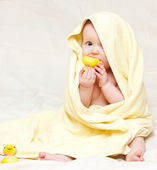 Infant with rubber duck — Stock Photo