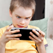 Boy playing game console — Stock Photo #14826825