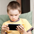 Boy playing game console — Stock Photo #14826837